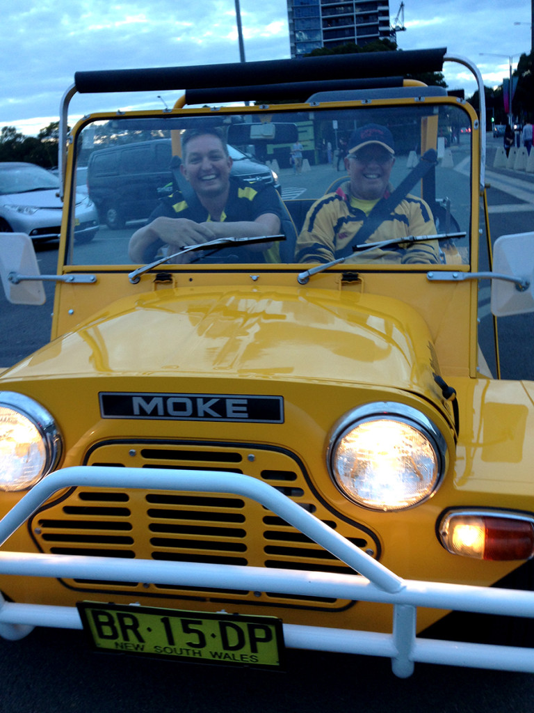 The drive home: Scott Plunkett and his father leave Homebush all smiles, in style in their canary-yellow 1981 mini Moke.