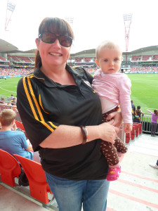 Local support: Sydney Tiger Fran Doughton, and baby Hattie, in the crowd.