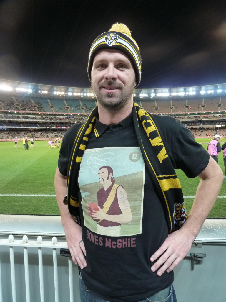 A chestfull of Tiger pride: Glenn Rigg, 34, from Princes Hill shows-off his Bones McGhie design classic at half time.